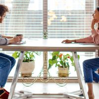 couple seated at desk discussing bank vs. credit union