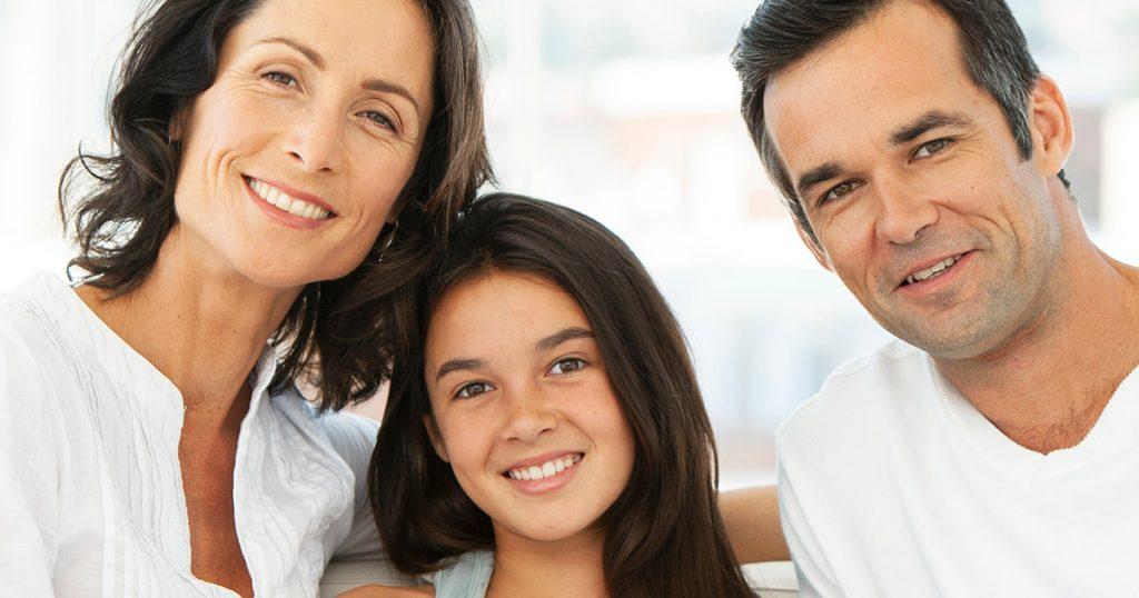 Parents saving 529 college saving plan for their daughter