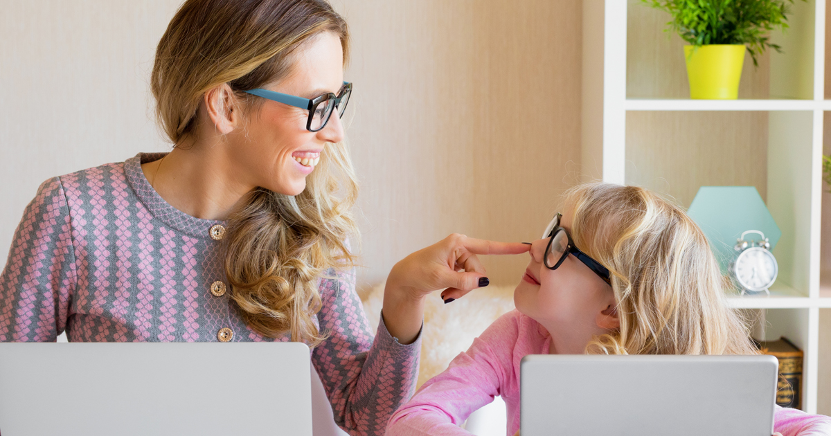 mom and daughter on computers