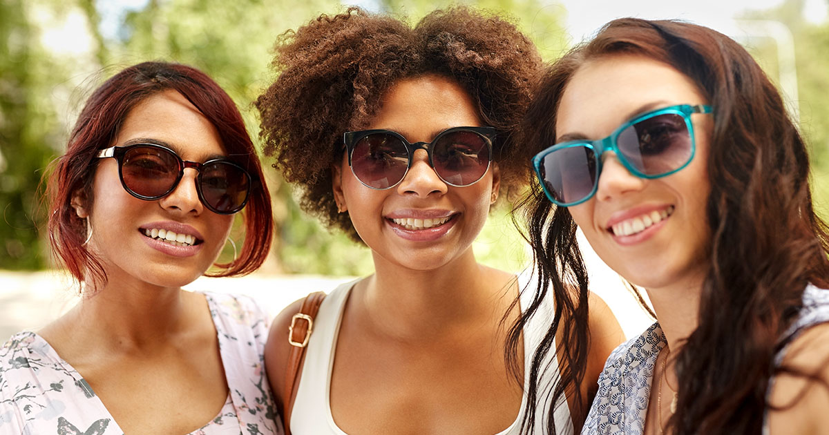 three woman smiling at camera