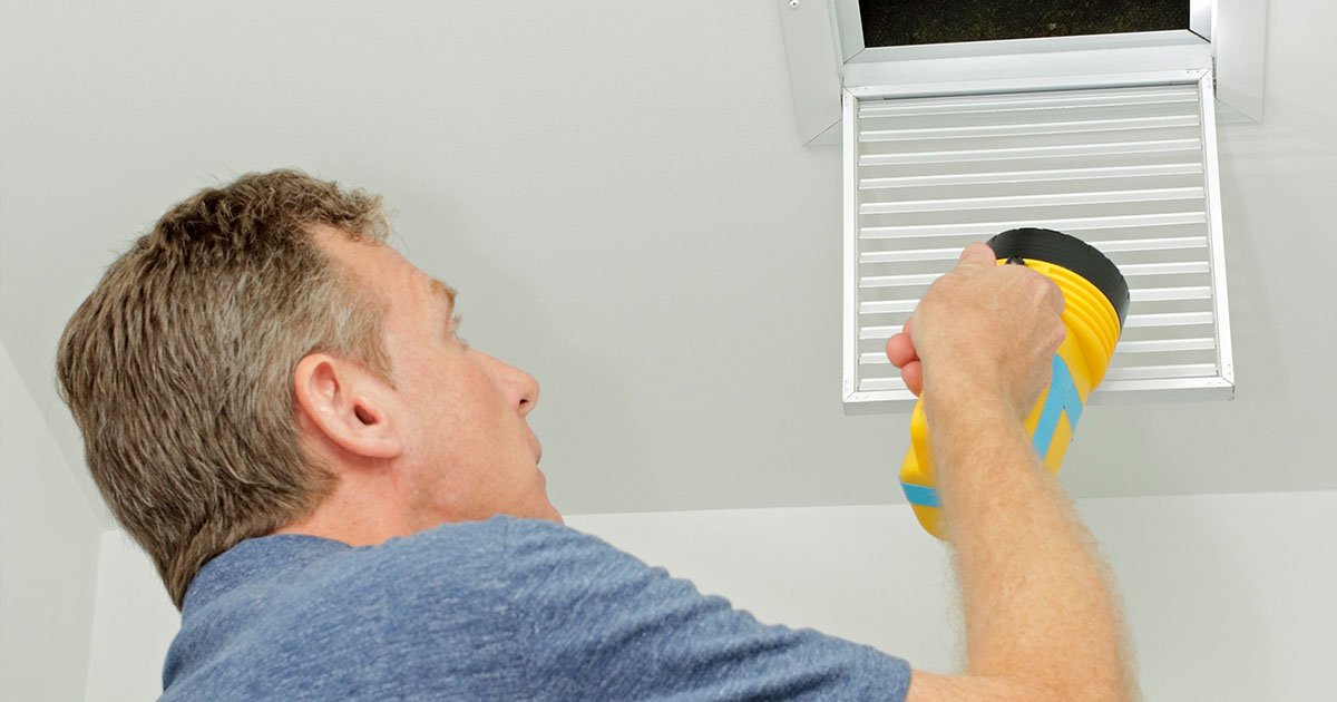 inspector checking vent