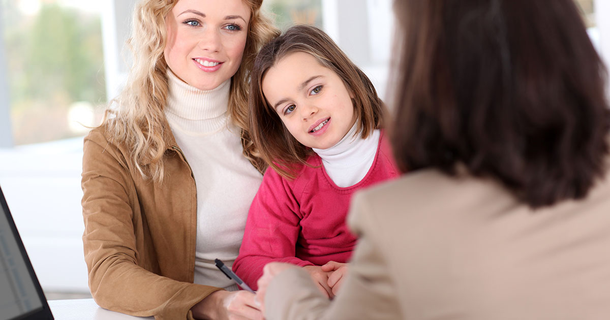 mother and daughter talking to financial professional