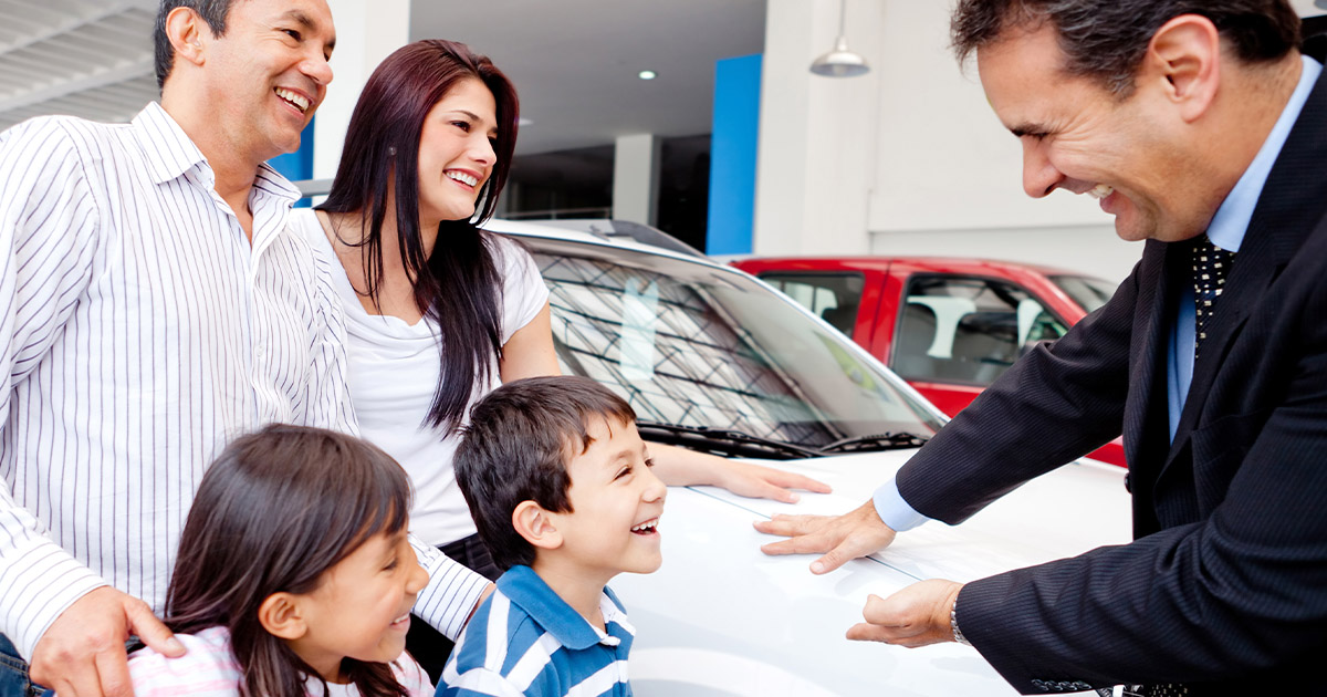 family with car salesman