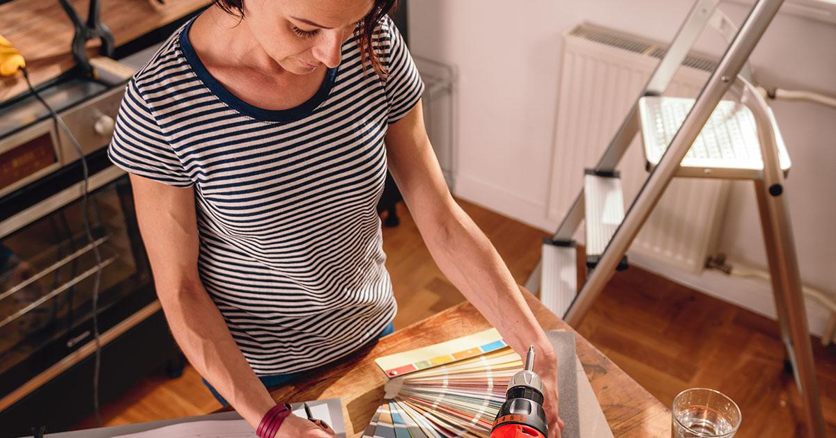 woman checking plans