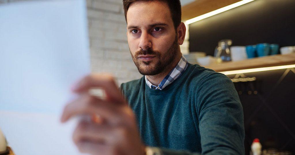 man looking at budget